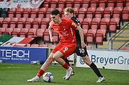Leyton Orient Conor Wilkinson (9) battles for possession with Tom Conlon (10) of Port Vale during the EFL Sky Bet League 2 match between Leyton Orient and Port Vale at the Breyer Group Stadium, London, England on 20 February 2021.