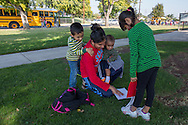 """Sanger, CA<br /> Socorro Alonso<br /> Giselle Alonso (5 years) <br /> Jorge Alonso (3 years) <br /> Julian Alonso (10 mos.)<br /> Socorro and her children pick Giselle up from school and share her work from the day.<br /> <br /> Giselle Alonso is a five-year-old girl that could change the future of her family.  She is a confident and bright girl, who speaks English and Spanish despite her family only speaking Spanish.  Her siblings depend on her for help with school; certificates of recognition attest her high performance.  With devotion to school, a supportive family, and good health, Giselle has every chance of achieving whatever she puts her mind to.  <br /> <br /> However, things could have turned out very differently for Giselle.  Her family moved to Sanger, CA only three years ago in search of more opportunities and support from family.  Socorro's day revolves around taking care of her and her three siblings.  """" I am alone and tired,"""" she shares, """"But it's worth it if my kids are happy.""""  Her father has a good job in the flooring business, but works long hours to provide for the family.  Socorro doesn't speak any English, and Giselle's older sister struggles with school.  <br /> <br /> Before moving to the Central Valley, the family found it difficult to pay rent and buy food in Santa Rosa, CA.  While they never went hungry, Socorro shared that she sometimes worried how she was going to get enough healthy foods.  She knew that buying unhealthy food and junk food might be cheaper, but knows the importance of nutrition especially when it comes to good health.  One medical issue could set the family back thousands of dollars.  Because of this, she cooks all of their meals with fresh produce and lean meats at home.  <br /> <br /> This isn't the reality for a great percentage of people where Giselle lives in Fresno County, where 16.2 percent of the population—about 24,340 people—struggles with food insecurity.  The assistance from the food pantry allows her mother """