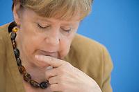 18 JUL 2014, BERLIN/GERMANY:<br /> Angela Merkel, CDU, Bundeskanzlerin, waehrend der sog. Sommer-Pressekonferenz der Bundeskanzlerin zu aktuellen Themen der Innen- und Außenpolitik, Bundespressekonferenz<br /> IMAGE: 20140718-01-023<br /> KEYWORDS: nachdenklich