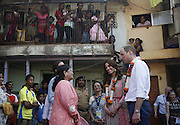 April 10, 2016 - Mumbai, INDIA - <br /> <br /> Britain's Prince William,along with his wife Kate, the Duchess of Cambridge, talks to people during their visit to an economically deprived urban area in Mumbai, India, Sunday, April 10, 2016. The royal couple began their weeklong visit to India and Bhutan, by laying a wreath at a memorial Sunday at Mumbai iconic Taj Mahal Palace hotel, where 31 victims of the 2008 Mumbai terrorist attacks were killed. <br /> ©Exclusivepix Media