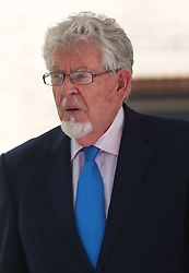 Rolf Harris leaves Southwark Crown Court in London after prosecutors said that they will not seek a second retrial after the jury was discharged when it failed to reach verdicts on four indecent assault charges against the former entertainer.