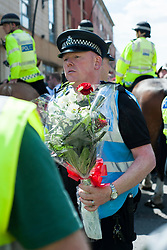 An EDL (English Defence League) organised event to lay flowers at Barkers Pool War Memorial Sheffield,  in memory of Drummer Lee Rigby, resulted in a two hour stand off when Sheffield Unite Against Fascism and One Sheffield Many Cultures supporters occupied Barkers Pool and surrounded the War Memorial leaving police to keep the opposing factions apart. <br /> South Yorkshire Police attempt to negotiate a compromise which would have involved a single police officer laying flowers at the Memorial<br /> 1 June 2013
