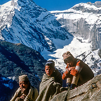 Village farmers who have trekked days from lowland Nepal admire the view after carrying baskets of their wares to sell at  the Saturday bazar in mountainous Namche Bazaar, leading town of the Sherpa people. Kwangde Peak rises behind.