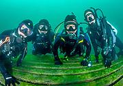 The group of scuba divers on the platform at Dutch Springs, Bethlehem, Pennsylvania