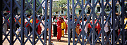 Young girl through school yard gate