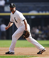 CHICAGO - SEPTEMBER 10:  Paul Konerko #14 of the Chicago White Sox fields against the Cleveland Indians on September 10, 2011 at U.S. Cellular Field in Chicago, Illinois.  The White Sox defeated the Indians 7-3.  (Photo by Ron Vesely)   Subject: Paul Konerko