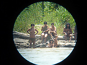 The Amazon's last lost tribe: Never-before-seen pictures capture the lives of Peruvian nomads who are untouched by civilization<br /> <br /> Never-before-seen photos have emerged of one of the last the last uncontacted Amazon tribes who the Peru government is trying to approach after they shot and killed two men in the chest with a bow and arrow.<br /> For 600 years the Mashco Piro clan – also known as Cujareno people – have lived in the forest in Peru close to the border with Brazil and had no contact with the outside world.<br /> But recently – threatened by 21st century logging, drugs cartels and tourism – the rarely seen indigenous tribe have broken cover from the forest to raid villages for food, tools and weapons to hunt.<br /> <br /> In May, Leonardo Perez, 20, was killed when he was shot with an arrow by tribe members who wanted his tools.<br /> In 2011 local guide Shaco Flores, a Matsigenka Indian, was murdered by the tribe.<br /> Shaco had given them machetes, pots and pans for 20 years and had developed a good relationship with the clan.<br /> But it is believed he was killed with an arrow to the heart after he tried to persuade them to settle and end to their nomadic hunter-gatherer life.<br /> 'The Mashco Piro have been present in this area for as long as anyone can remember, and have in a way been enticed out of their forest home onto the riverbanks by missionaries and other missionised indigenous people,' Rebecca Spooner for campaign group International Survival told MailOnline.<br /> 'They have been given pots and land and machetes, and are now asking for more.'<br /> The increasing contact between the Mashco Piro people and other indigenous communities is slowly peeling back the layers of secrecy that have shielded them from modern society.<br /> Members of the tribe have been spotted a record 100 times already this year, Peru's deputy culture minister Patricia Balbuena said.<br /> While others have even left the forest and now live among the neighb