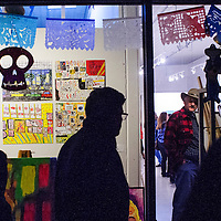 101114       Cable Hoover<br /> <br /> ArtsCrawl patrons stream past a Halloween display in the windows of Art123 Gallery during ArtsCrawl in downtown Gallup Saturday.
