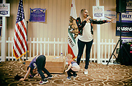 SAN DIEGO, CA MAY 5, 2018:  Shastina Sandman, a GOP candidate running for congress in California's 48th district, gives a campaign speech while her kids Avery,4, and Ayden,2, play, at the California Republican party convention in San Diego, CA on Saturday, May 5, 2018.  Sandmnan, is one of a few female Republican candidates running for office on a pro-Trump platform.(Photo by Sandy Huffaker for The Washington Post)