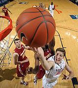 Dec. 30, 2010; Charlottesville, VA, USA; Virginia Cavaliers forward Will Sherrill (22) shoots the ball in front of Iowa State Cyclones forward Jamie Vanderbeken (23) during the game at the John Paul Jones Arena. Iowa State Cyclones won 60-47. Mandatory Credit: Andrew Shurtleff