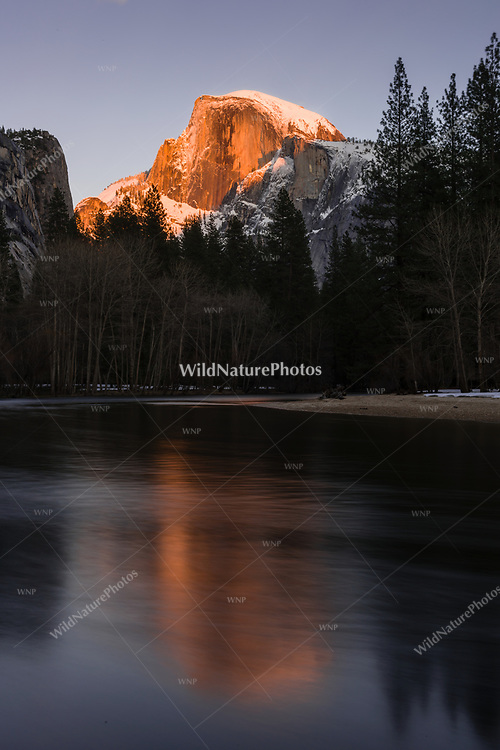 Half Dome in Yosemite National Park at sunset with reflections