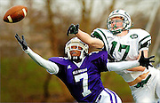 """Old Bridge receiver Julian Daley (left) and East Brunswick defensive back Timothy O'Sullivan (right) extend their bodies for the ball during the fourth quarter of the 15th annual """"Battle of Route 18"""" game at Old Bridge High School's Lombardi Field in Old Bridge, New Jersey on November 27, 2009.  East Brunswick kicker Tyler Yonchiuk missed a 31-yard field goal wide left as time expired, lifting the hometown Knights to a 24-21 victory."""