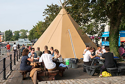 © Licensed to London News Pictures; 05/09/2021; Bristol, UK. People enjoy warm weather at The Ostrich pub by the city docks with covered outside seating areas and tipis. The Government is consulting on plans to allow some of the extra seating at pubs and bars including marquees introduced for outdoor hospitality to reduce the spread of Covid during the coronavirus pandemic to continue. The hospitality industry has welcomed the plans which include supporting outdoor markets by giving powers to local councils to grant them for an unlimited number of days. Photo credit: Simon Chapman/LNP.