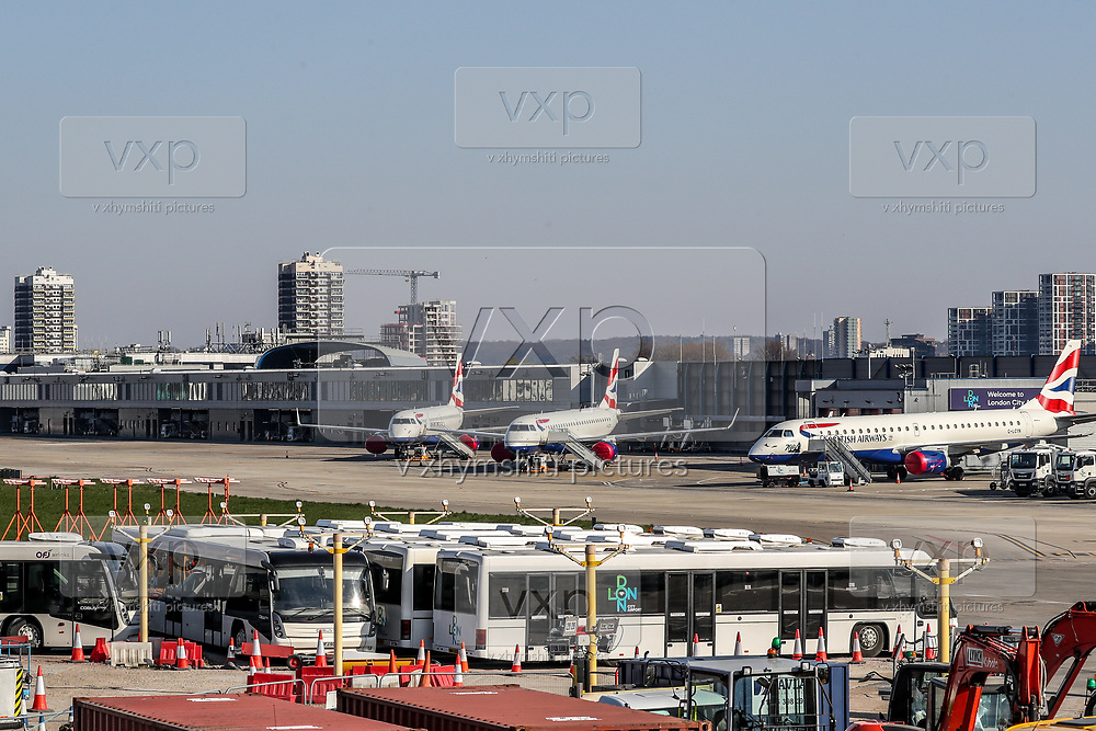 British Airways planes are parked up at London City Airport, in east London, Thursday, March 26, 2020, the airport is closed till at least the end of April. The airport is next to the ExCel Centre and may be used to help with logistics as the British Government announced Tuesday, that the ExCel Center in east London will become a 4,000-bed temporary hospital to deal with future coronavirus patients, to be called NHS Nightingale. (Photo/Vudi Xhymshiti)