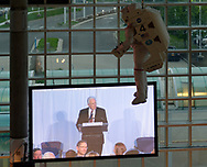 Garden City, New York, U.S. June 6, 2019. On stage, speaker is seen on giant screen, from third level of atrium of Cradle of Aviation Museum, during Apollo at 50 Anniversary Dinner, an Apollo astronaut tribute celebrating the Apollo 11 mission Moon landing. U.S. Navy Blue Angels Grumman F-11A Tiger jet is suspended from ceiling.