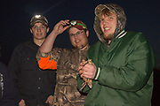 Wildlife ecology students Sam Lau (right) Austin Fischer (center, partially obscured) and Jeff Williams, from University of Wisconsin-Stevens Point preparing to release a male woodcock which they recently banded near Bancroft, Wisconsin.