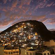 A contrast between the hotels at Copacabana beach and the favela Morro dos Cabritos just behind Copacabana beach, Rio de Janeiro,  Brazil. 19th July 2010. Photo Tim Clayton