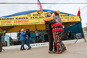 Revelers dance to a Cajun Zydeco band during the Tee Mamou Courir de Mardi Gras heritage festival on Fat Tuesday February 17, 2015 in Iota, Louisiana.
