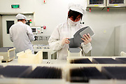 Employees assemble photovoltaic panels at Suntech Power Holdings Co.'s factory in Wuxi, Jiangsu Province, China, on Wednesday, Nov. 16, 2011. Suntech is  the world's biggest maker of silicon-based solar panels while China as a whole dominates the manufacturing of solar power panels.