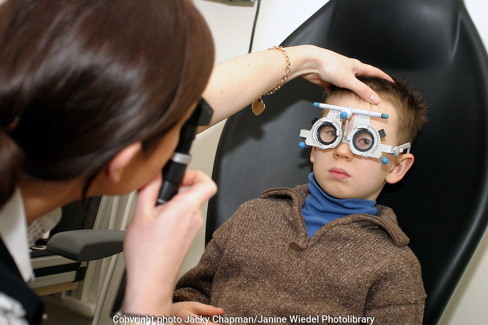 Young child having eyes tested with optical goggles being tested