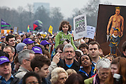 A young girl watches the speeches during the rally at the TUC March for the Alternative 26 March 2011, Hyde Park London.