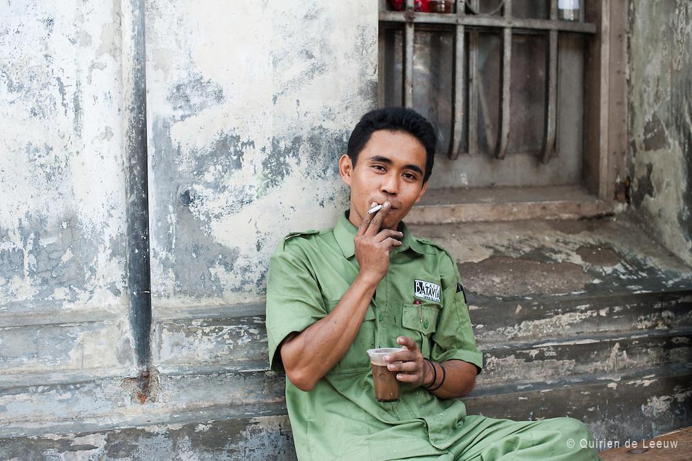 Man at Cafe Batavia, Jakarta Kota. Java, Indonesia