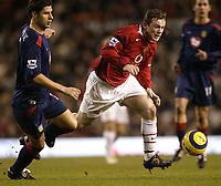 Photo Aidan Ellis. Digitalsport<br /> Manchester United v Portsmouth.<br /> FA Barclays Premiership.<br /> Old Trafford, Manchester.<br /> 26/02/2005.<br /> United's Wayne Rooney gets away from Pompey's Arjun De Zeuw