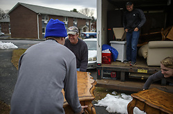 November 21, 2018 - Vernon, CT, USA - Journey Home movers, from left, Danny Brewer, Matt Brewer, Rob Dulitsky and Alison Scharr unload furniture at Alexandra Feliciano's apartment, where she moved about 10 days ago after living in a shelter for 5 1/2 months, on Wednesday, Nov. 21, 2018. (Credit Image: © Mark Mirko/Hartford Courant/TNS via ZUMA Wire)
