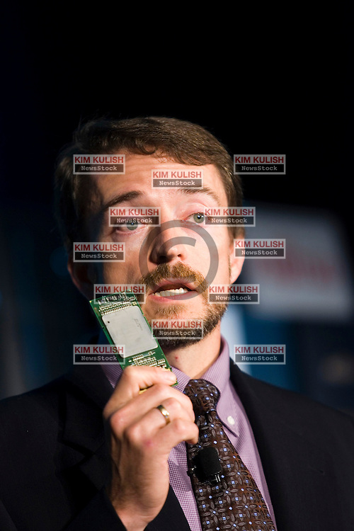 Pat Gelsinger, senior vice president and general manager of the Digital Enterprise Group at Intel Corp., holds the Dual-Core Intel Itanium 2 9000 Series Processor, previously codenamed Montecito, at an event in San Francisco July 18, 2006. On Tuesday Intel unveiled five 9000 Series processors, designed for use in business analytics, large data warehouses and high-performance computing. Each processor is made up of 1.7 billion transistors  Photo by Kim Kulish