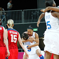 07 August 2012: France Celine Dumerc and Edwige Lawson-Wade celebrate the win following 71-68 Team France victory over Team Czech Republic, during the women's basketball quarter-finals, at the Basketball Arena, in London, Great Britain.