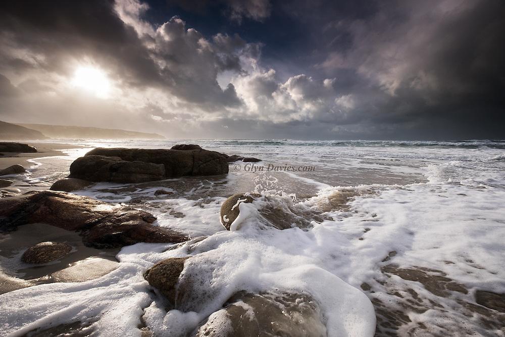 Surf foam at Gwenver Beach, South West Cornwall