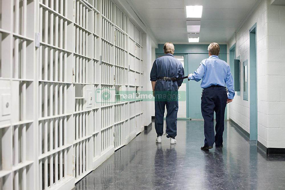 Jul. 25, 2012 - Prisoner and guard (Credit Image: å© Image Source/ZUMAPRESS.com)