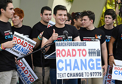"""Stoneman Douglas student Cameron Kasky, center, gives a thumbs up after announcing on June 4, 2018, in Parkland, FL, USA, that this summer the students of March For Our Lives are making stops across America to get young people educated, registered and motivated to vote, calling it """"March For Our Lives: Road to Change."""" Photo by Taimy Alvarez/Sun Sentinel/TNS/ABACAPRESS.COM"""