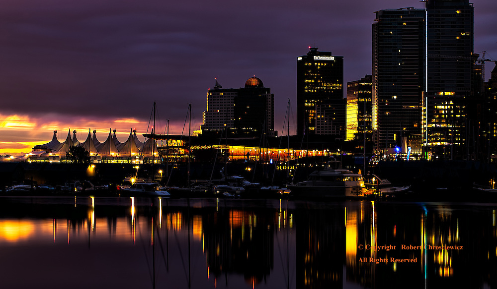 Dawn Over Vancouver: The morning sky parts in dramatic fashion over the Convention Centre, part of the Vancouver skyline in British Columbia Canada.