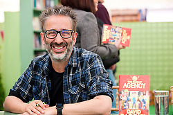 © London News Pictures. 25/05/2015. Hay-on-Wye, Powys, Wales, UK. David Baddiel signs copies of his book The Parent Agency at the Hay Festival 2015. Photo credit : Graham M. Lawrence/LNP.