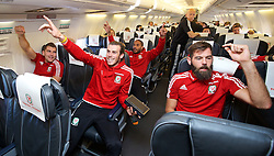 ZENICA, BOSNIA & HERZEGOVINA - Sunday, October 11, 2015: Wales' Sam Vokes, Gareth Bale, captain Ashley Williams and Joe Ledley on the team's return flight to Cardiff after qualifying for the UEFA Euro 2016 finals despite a 2-0 defeat to Bosnia and Herzegovina during the UEFA Euro 2016 qualifying match. (Pic by David Rawcliffe/Propaganda)