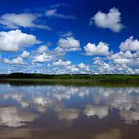 South America, Peru, Amazon. Cloud reflections on Amazon river.