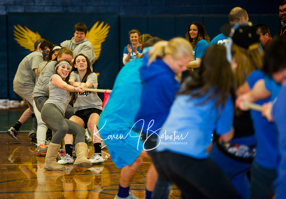 The Freshman class takes the Juniors over the line during the Tug 'O War event at Gilford High School's Winter Carnival on Friday afternoon.  (Karen Bobotas/for the Laconia Daily Sun)