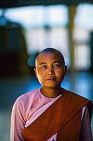 Buddhist nun, Kyauktan Pagoda (a.k.a. Ye Le Paya), in the middle of the river, near Syriam, Burma (Myanmar)