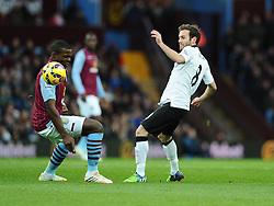 Manchester United's Juan Mata flicks the ball over Aston Villa's Jores Okore  - Photo mandatory by-line: Joe Meredith/JMP - Mobile: 07966 386802 - 20/12/2014 - SPORT - football - Birmingham - Villa Park - Aston Villa v Manchester United - Barclays Premier League