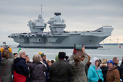 © Licensed to London News Pictures. 16/11/2019. Portsmouth, UK.  Crowds watch on as HMS Prince of Wales, the Royal Navy's second Queen Elizabeth-class aircraft carrier, sails into Portsmouth Naval Base for the first time this afternoon, 16th November 2019. The £3.1 billion warship has been undergoing eight weeks of sea trials in the Moray Firth. Photo credit: Rob Arnold/LNP