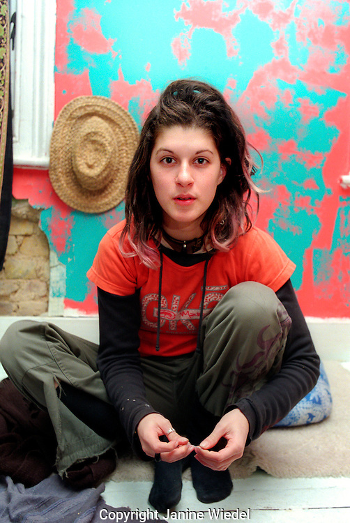 Young Russian woman living in South london squat.