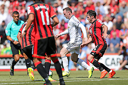 Wayne Rooney of Manchester United is surrounded by Bournemouth players - Rogan Thomson/JMP - 14/08/2016 - FOOTBALL - Vitality Stadium - Bournemouth, England - Bournemouth v Manchester United - Premier League Opening Weekend.