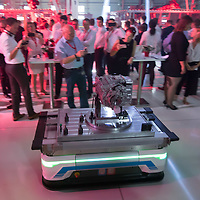 Robot brings products among guests during the E-Engine production start of electric engines at the Audi car factory in Gyor (about 120 km West of Budapest), Hungary on July 24, 2018. ATTILA VOLGYI