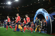 the match officials walk out as Laurent Koscielny of Arsenal leads his team from the tunnel for the start of the match. UEFA Champions league group A match, Arsenal v FC Basel at the Emirates Stadium in London on Wednesday 28th September 2016.<br /> pic by John Patrick Fletcher, Andrew Orchard sports photography.