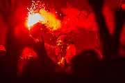 The Arctic Monkeys play the Pyramid Stage as flares are let off in the audience. The 2013 Glastonbury Festival, Worthy Farm, Glastonbury. 28 June 2013.