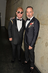 Left to right, SIR ELTON JOHN and DAVID FURNISH at the GQ Men of The Year Awards 2016 in association with Hugo Boss held at Tate Modern, London on 6th September 2016.