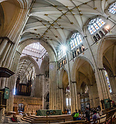 """York Minster, built over 250 years 1220-1472 AD, is one of the finest medieval buildings in Europe. Also known as St Peter's, its full name is """"Cathedral and Metropolitical Church of St Peter in York,"""" located in England, United Kingdom, Europe. York Minster is the seat of theArchbishop of York, the second-highest office of the Church of England.""""Minster"""" refers to churches established in the Anglo-Saxon period as missionary teaching churches, and now serves as an honorific title.York was founded by the Romans as Eboracum in 71 AD. As the center of the Church in the North, York Minster has played an important role in great national affairs, such as during the Reformation and Civil War. This image was stitched from multiple overlapping photos."""
