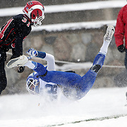 Kyle Gifford, Darien, is tackled by Michael DiCosmo, New Canaan, during the New Canaan Rams Vs Darien Blue Wave, CIAC Football Championship Class L Final at Boyle Stadium, Stamford. The New Canaan Rams won the match in snowy conditions 44-12. Stamford,  Connecticut, USA. 14th December 2013. Photo Tim Clayton