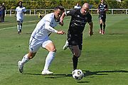 Auckland City FC's Kayne Vincent and Hawke's Bay United's Bill Robertson chase the ball in the Handa Premiership football match, Hawke's Bay United v Auckland City FC, Bluewater Stadium, Napier, Sunday, January 31, 2021. Copyright photo: Kerry Marshall / www.photosport.nz